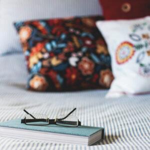 Emma Mattress glasses book in bed