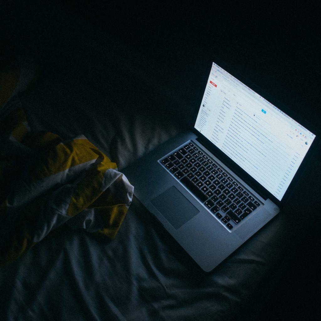 Emma Mattress laptop in bed