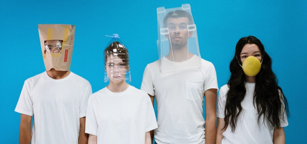 Models wear spoof improvised fashion masks